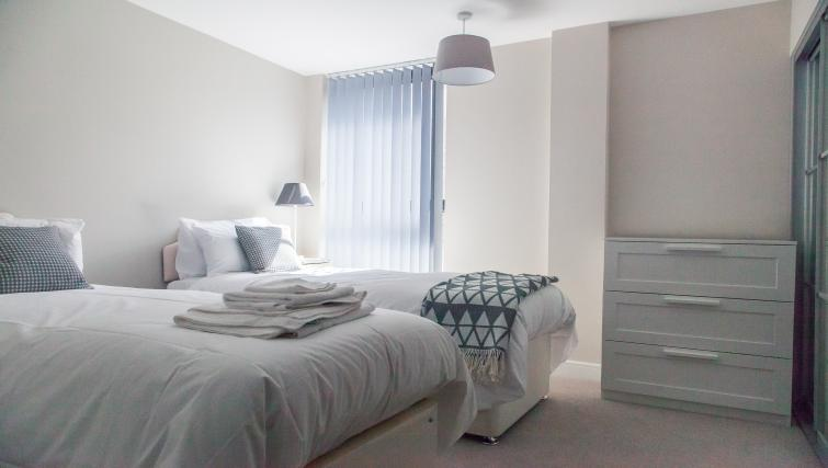 Twin beds at The Bellerby Apartments