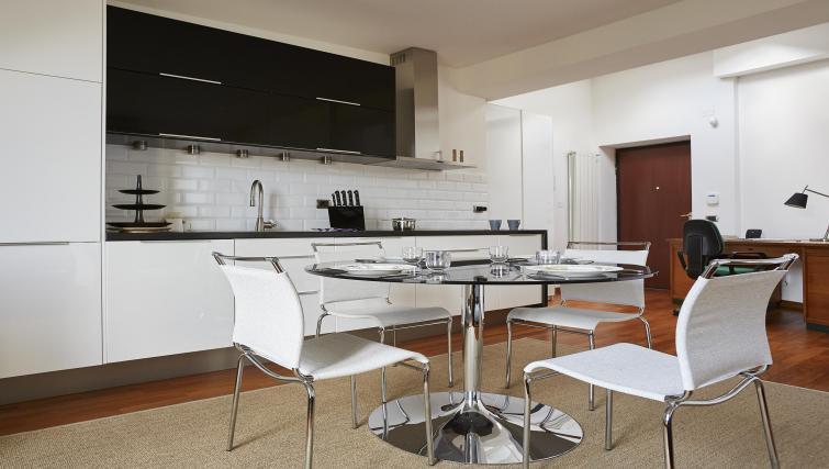 Dining table at Eustachi Apartment