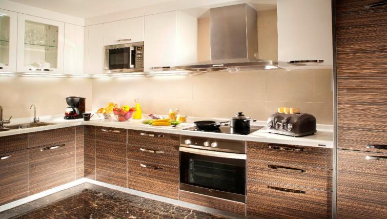 Equipped kitchen at Oakwood Premier Guangzhou